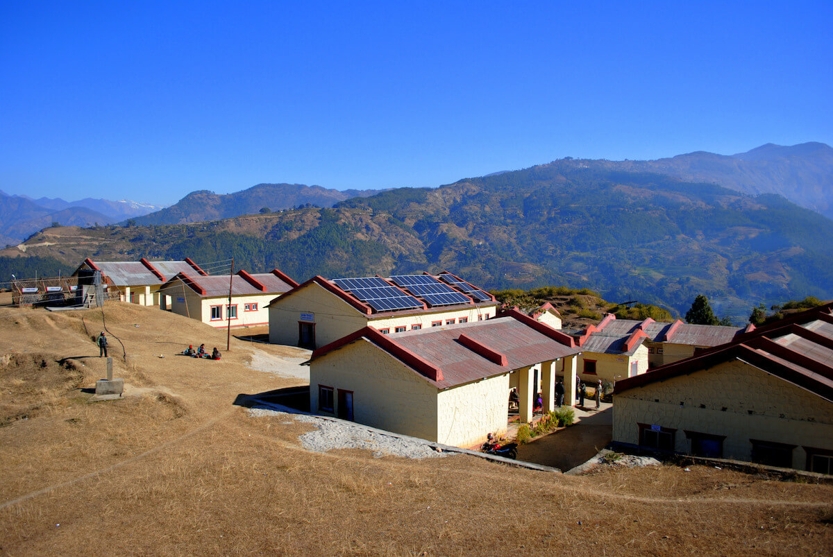 Buildings in Nepal with solar panels from SunFarmer