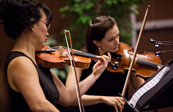 MaRSian Melissa Hughes (right)  and the Toronto Orchestra play at the ceremony