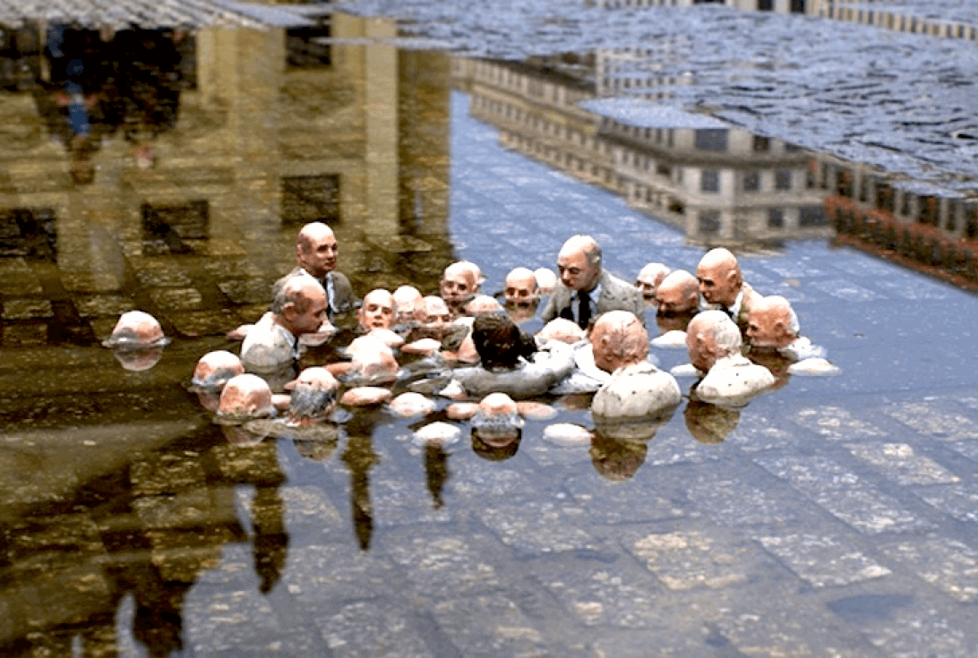 "Isaac Cordal's tiny cement sculpture in Berlin: ""Follow the Leaders"" – politicians discussing climate change."
