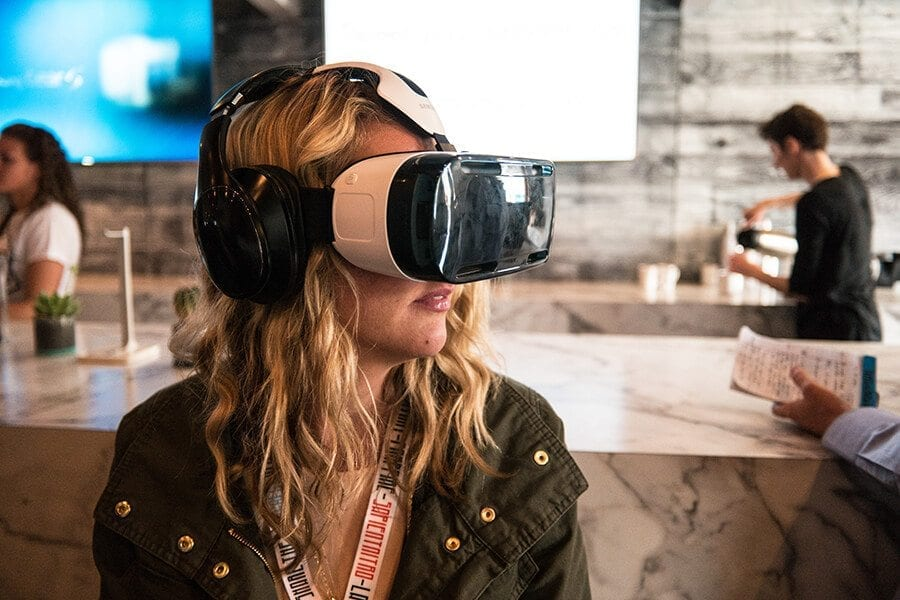 Woman wearing Samsung VR virtual reality headset