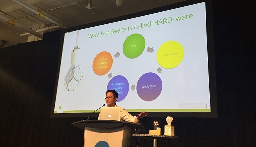 "Gimmy Chu of Nanoleaf speaking at MaRS Mornings, presenting the ""Why Hardware is called HARD-ware"" slide."