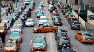 taxi drivers protesting in Toronto by blocking roadways