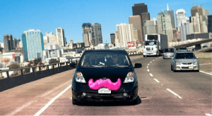 a Lyft vehicle with the signature pink mustache
