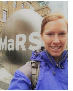 Picture of Jodi-Jane in front of MaRS sign